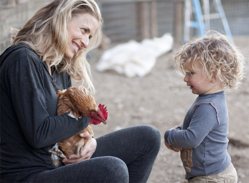mom and boy with chicken